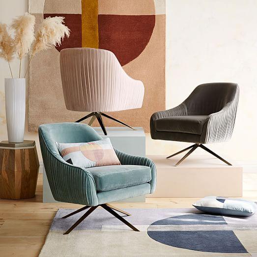 Blush and muddy turquoise modern swivel chairs.