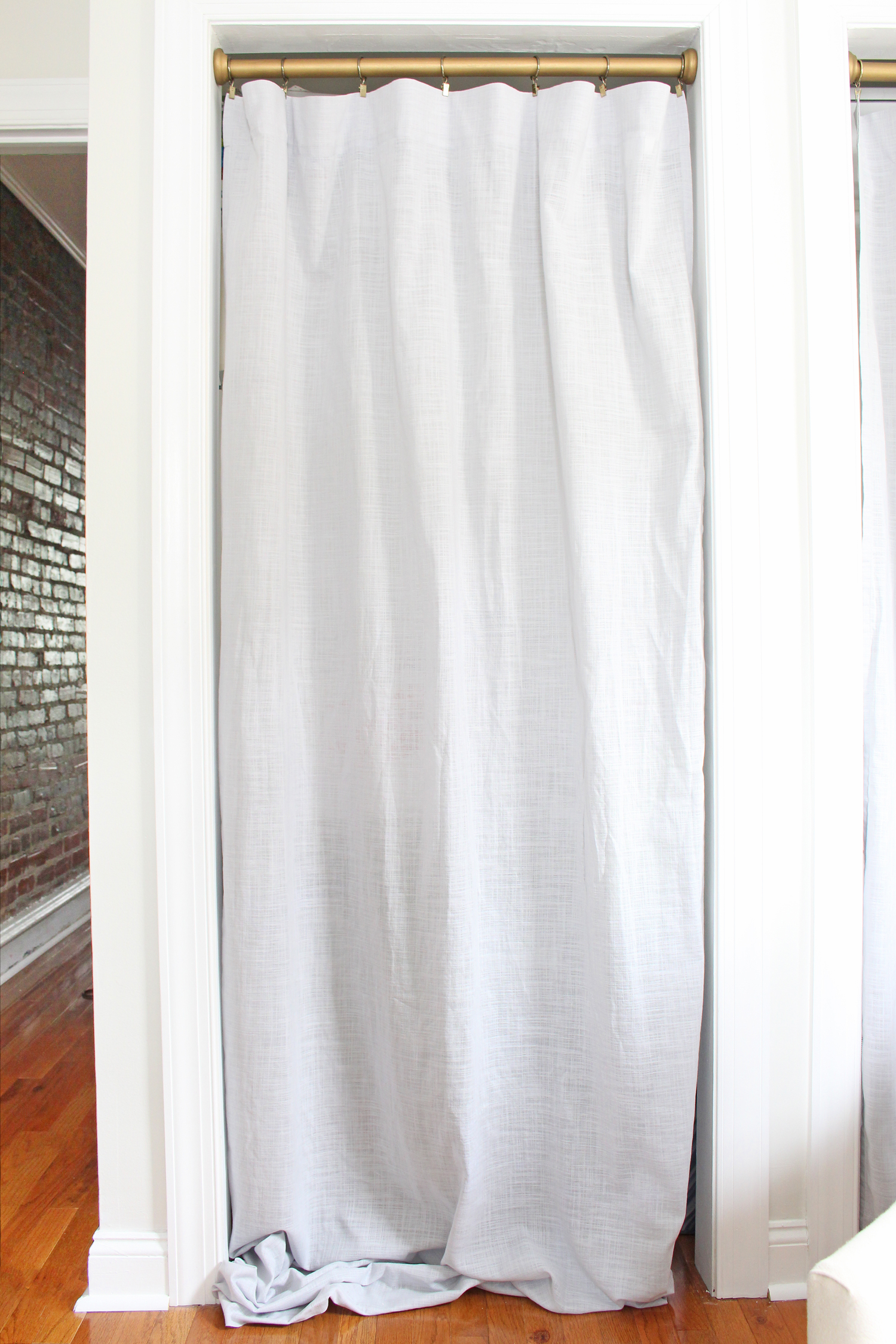 Using a curtain as an alternative to bifold closet doors (prior to hemming curtains).