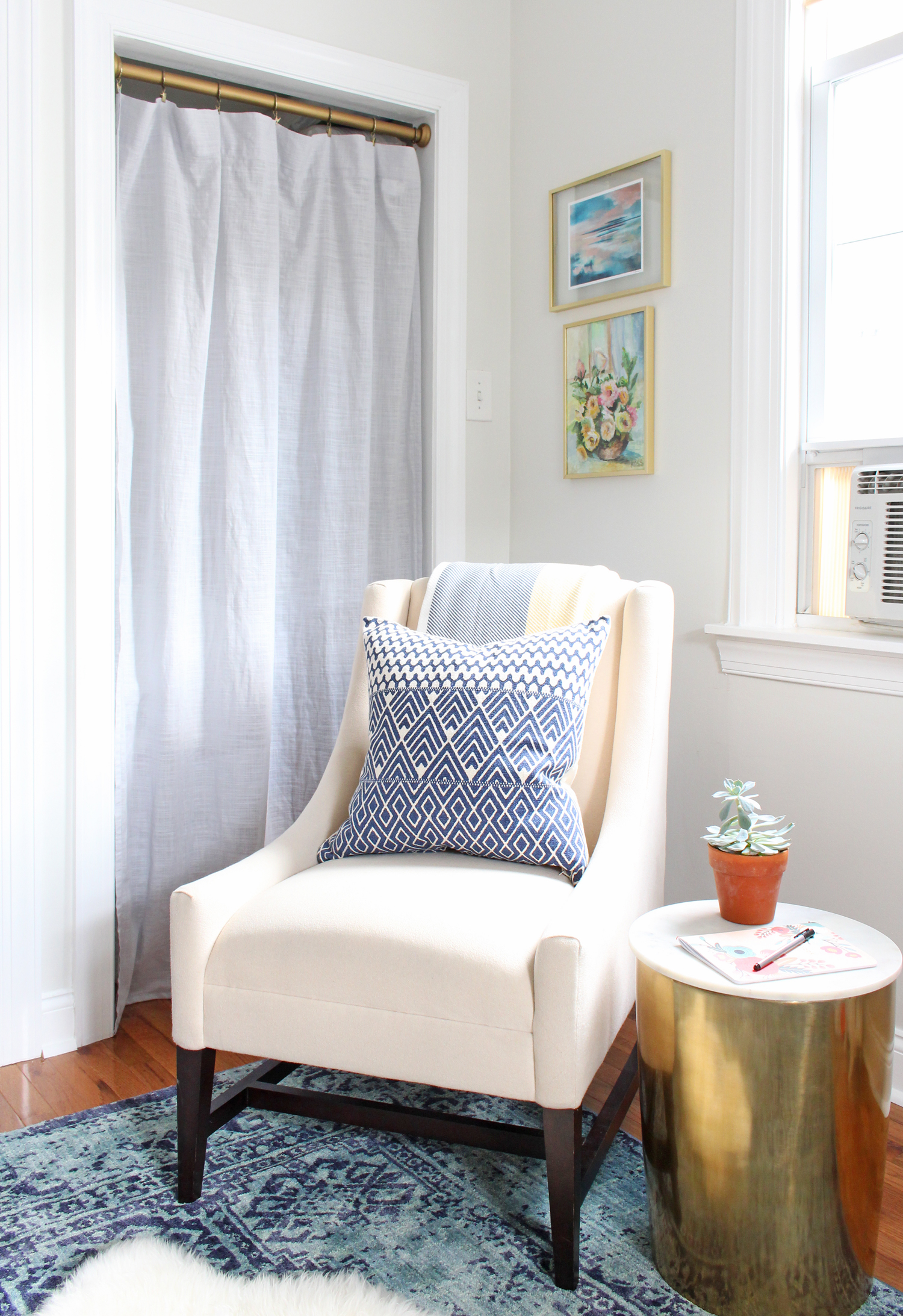 Cozy corner for reading and watching TV in Mix & Match Design Company's home office.