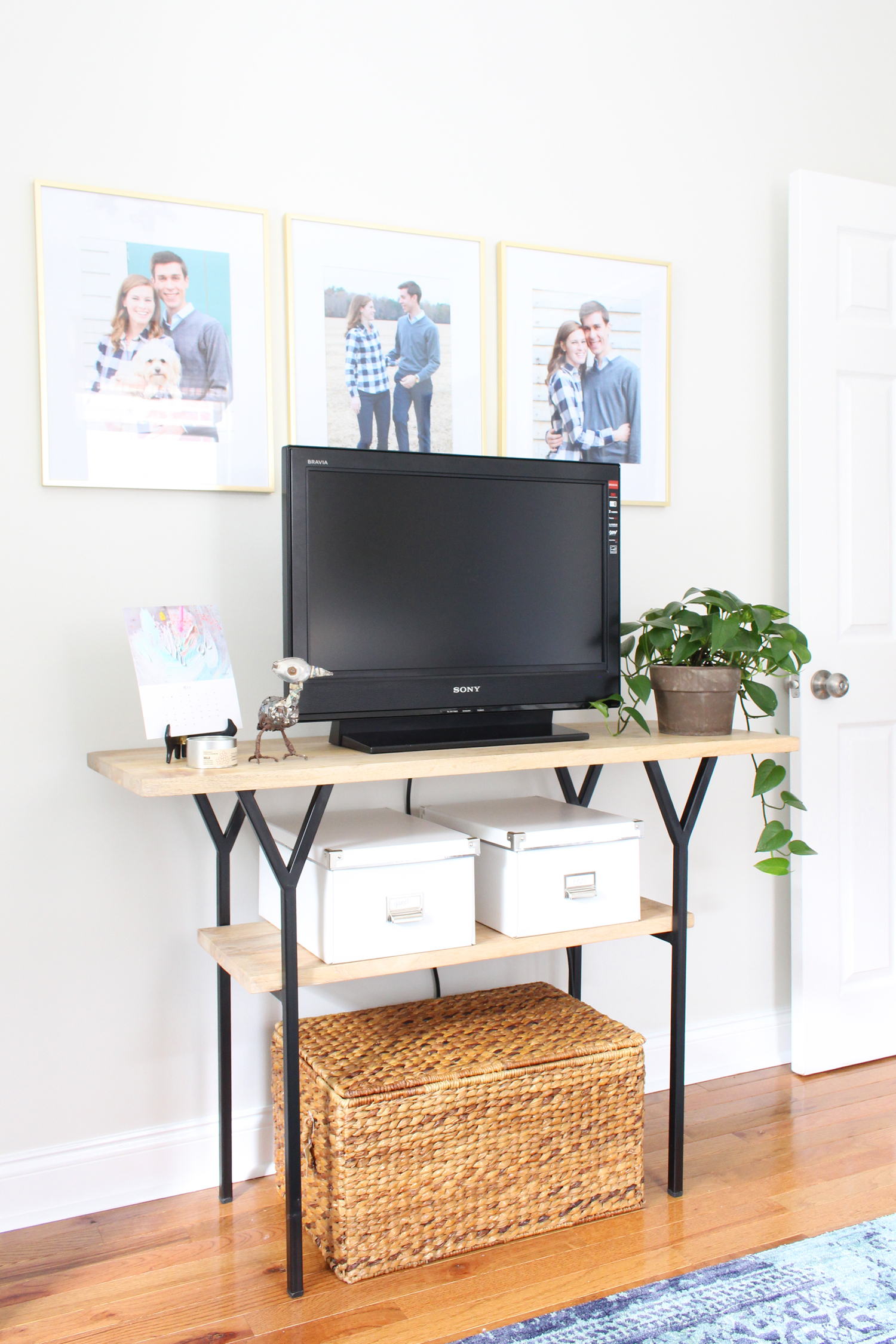 Using a console table as a TV stand in a home office.