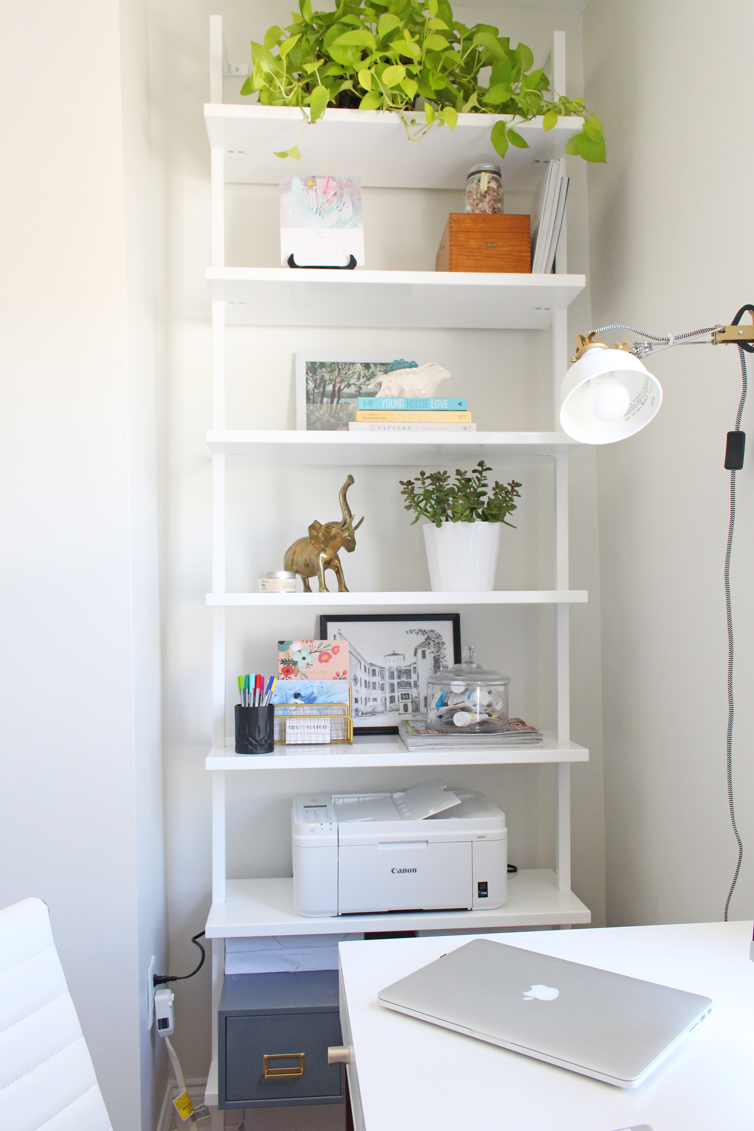 The CB2 Stairway bookcase is the perfect modern storage solution in a home office or living space.
