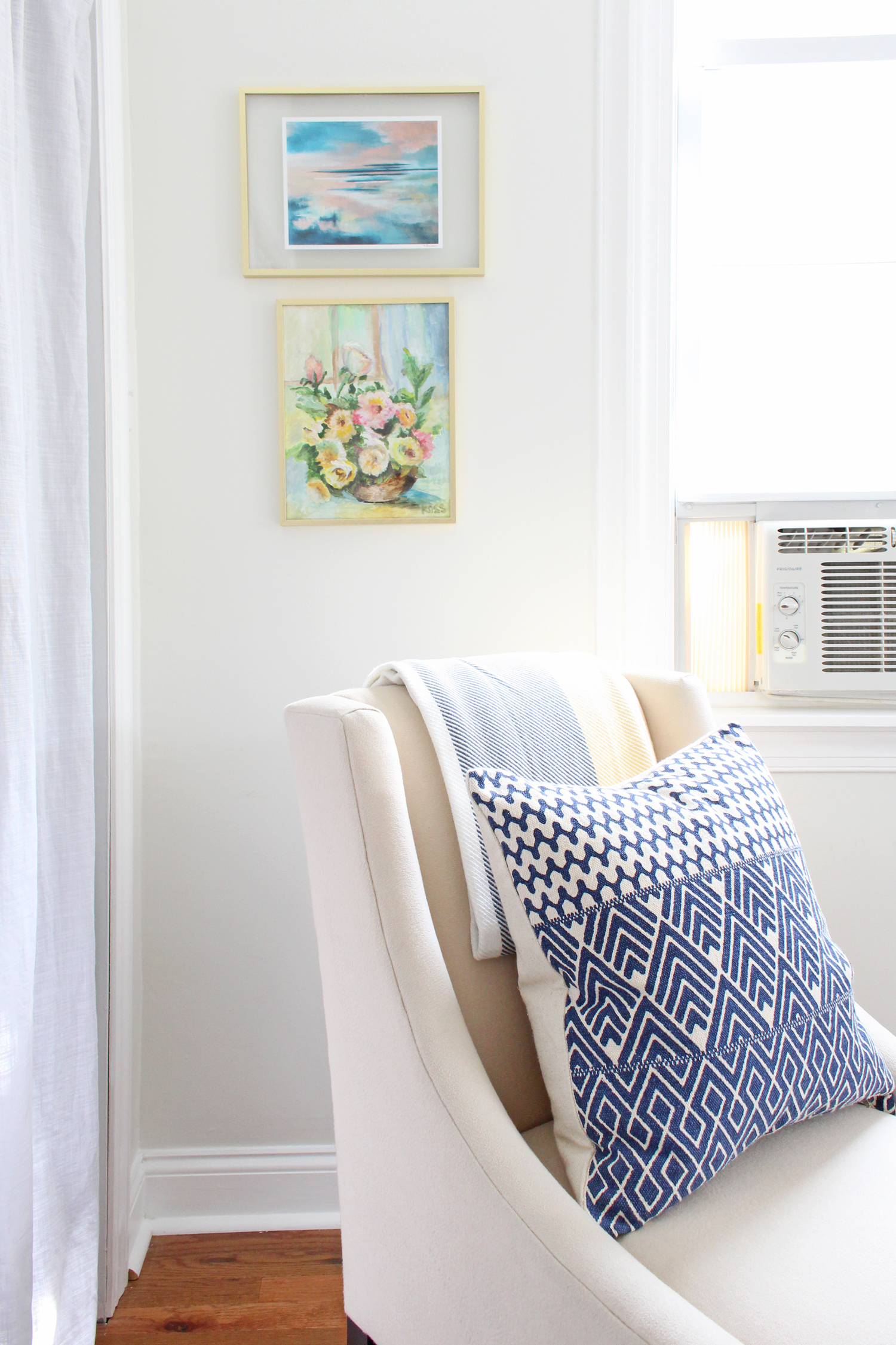 An abstract print from Modern South Studio and a vintage botanical painting add color and style to this corner of the office.