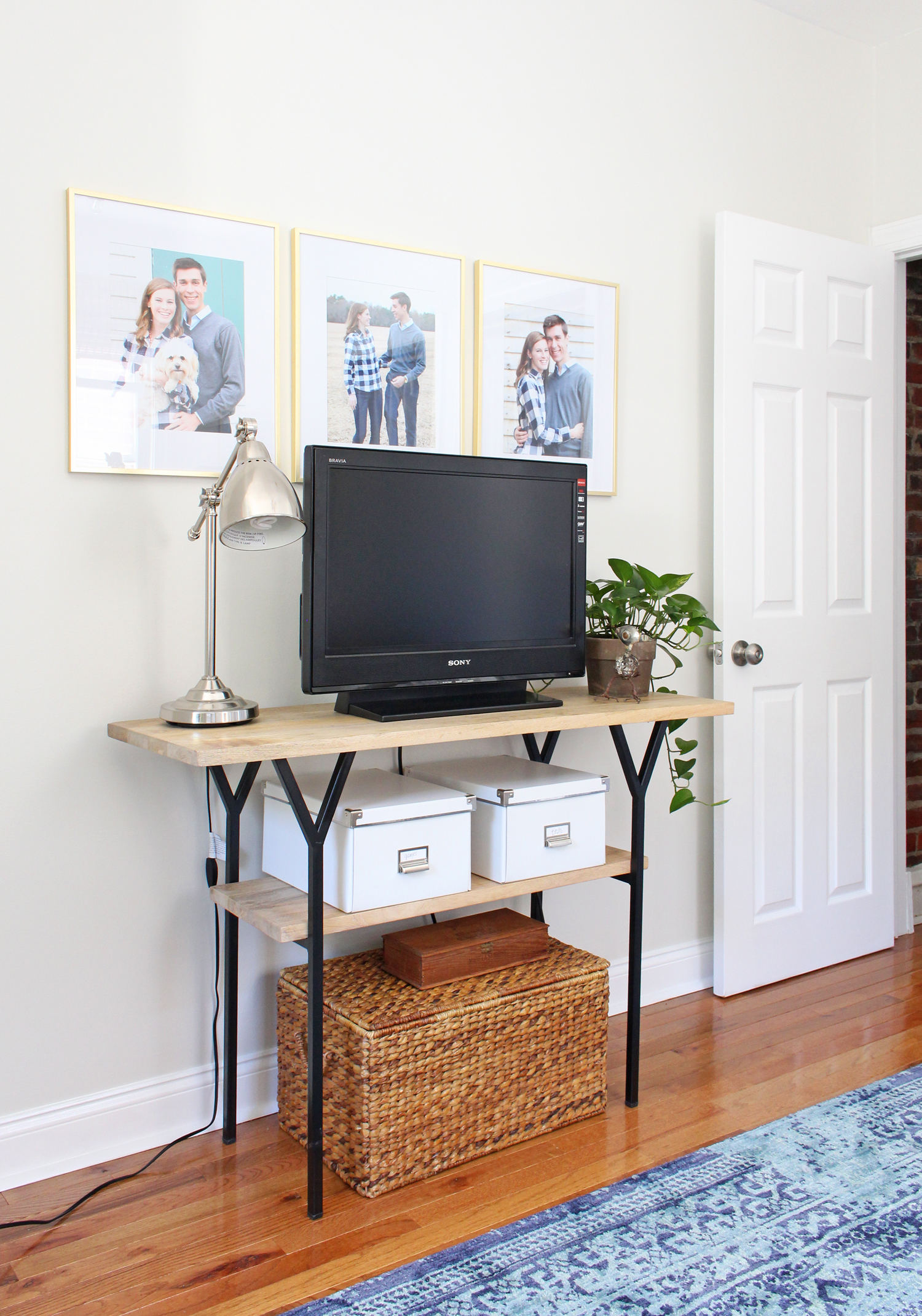 Industrial modern TV console in home office.
