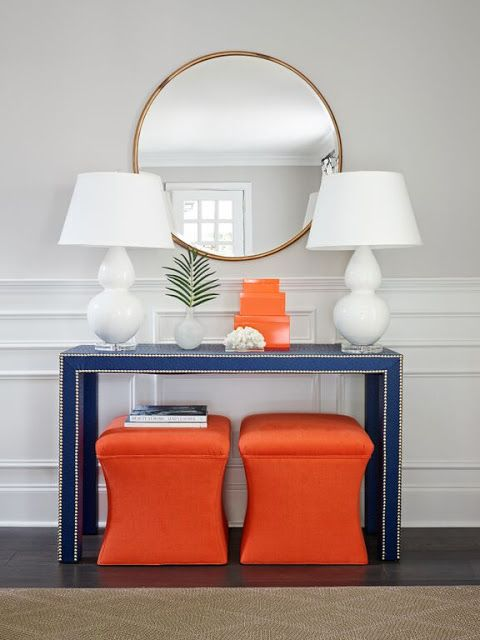 Bright and colorful entryway with console table, mirror and upholstered stools from Stephanie Kraus Designs.