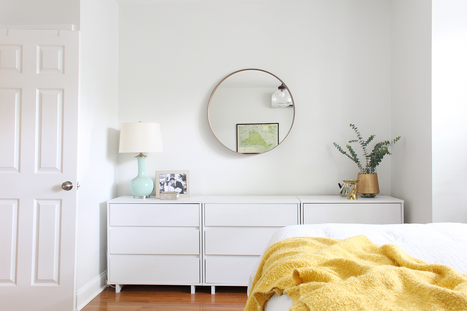A row of three budget-friendly, modern dressers from Target fill this bedroom nook perfectly.
