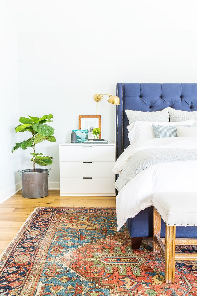 Get the look of this modern traditional bedroom from Ausland Interiors on the blog. // Blue upholstered bed, upholstered headboard, vintage rug, persian rug.