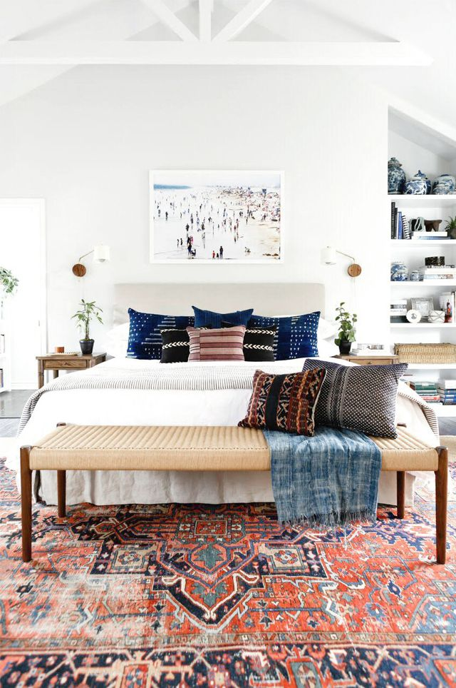 How to decorate around a bed. Eclectic boho bedroom. // Hang art over bed, hang above bed