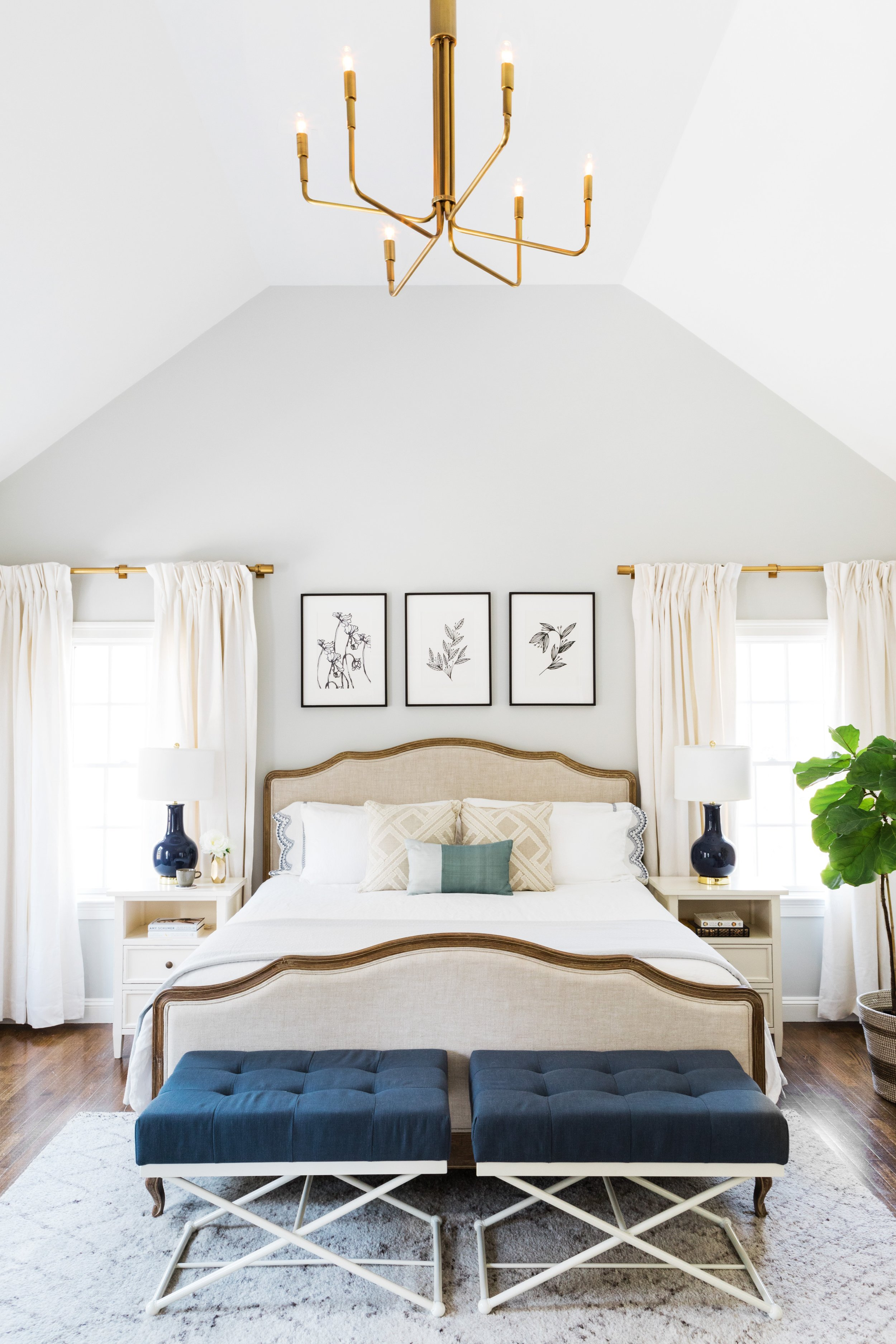 How to decorate around a bed. One option:hang art centered on the wall above the headboard. (Design: Oh, I Design) // traditional bedroom, neutral bedroom, upholstered bed