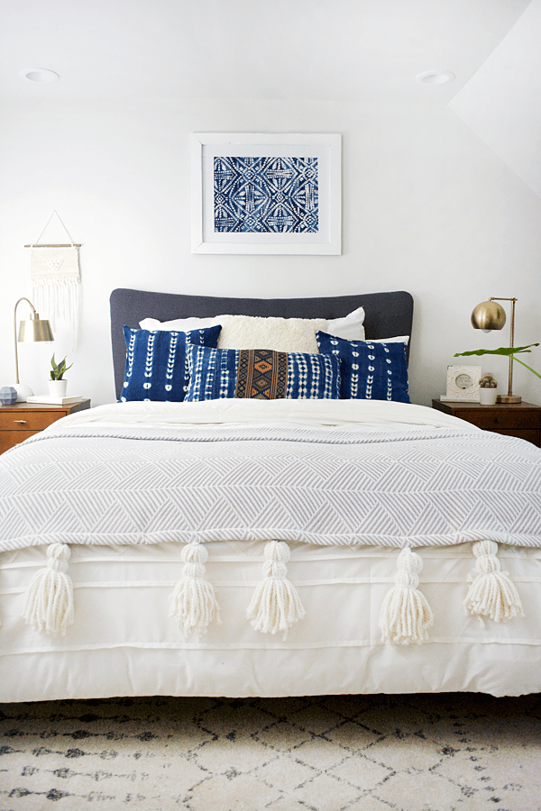 How to decorate around a bed. Hang a single piece of art above the bed (Design: Repurposed) // modern bohemian bedroom, art above bed, diy art