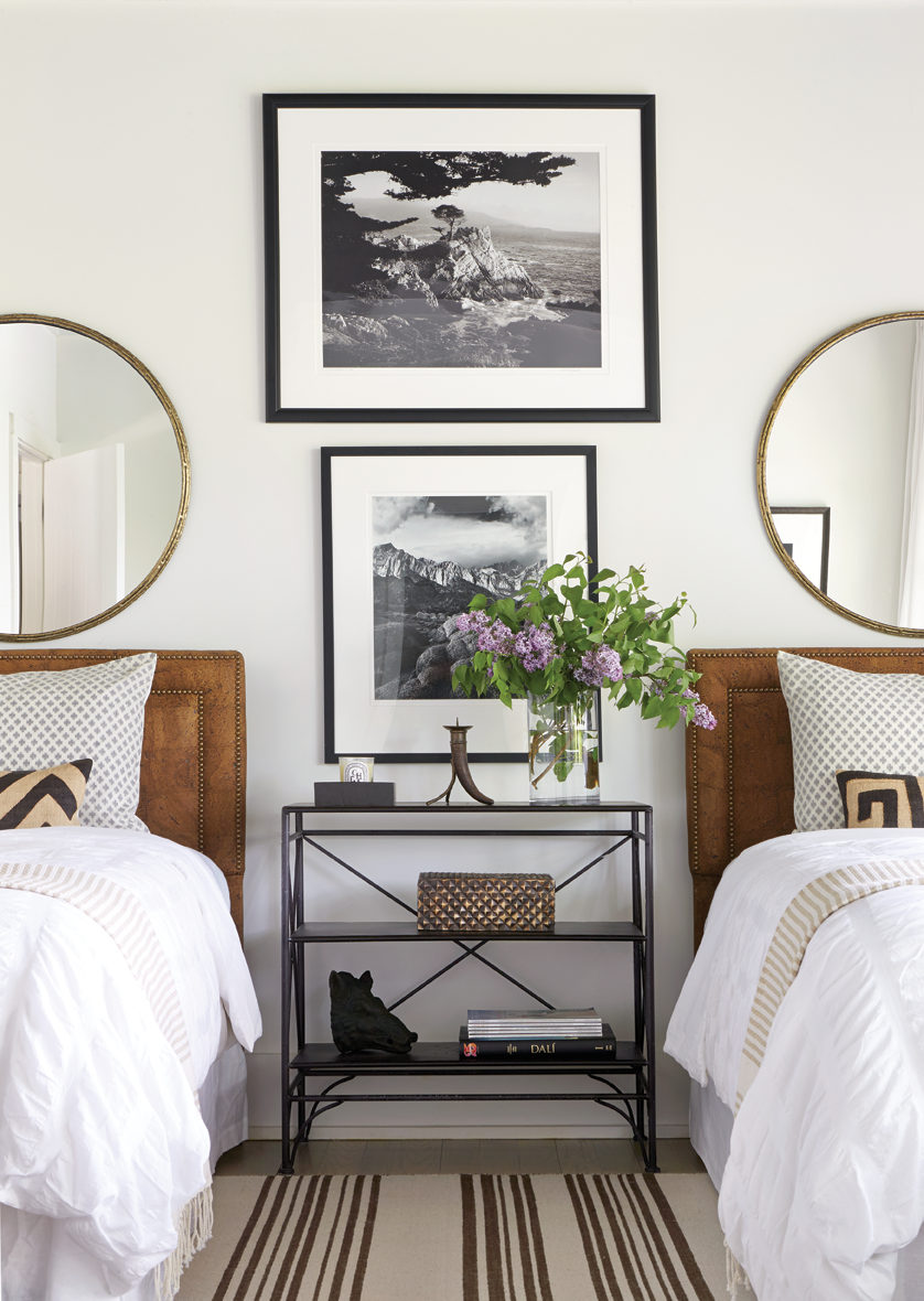 How to decorate around beds. Option: hang round mirrors above twin beds (Design: Andrew Brown) //twin bedroom, guest bedroom, neutral bedroom, traditional modern bedroom
