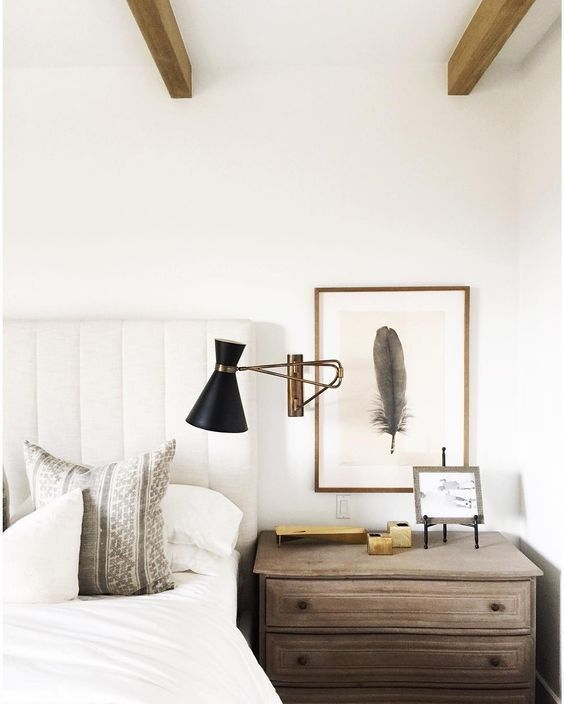 How to decorate walls in a bedroom: hang art above nightstands (Design: Nicole Davis). // neutral transitional bedroom, art above bedside tables, coastal modern bedroom
