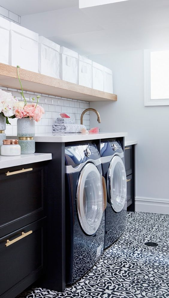 Tiled walls and floor in laundry room