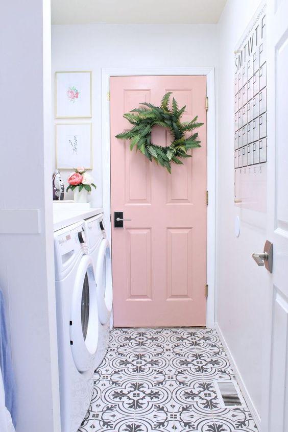Pink door, cement tile in laundry room.