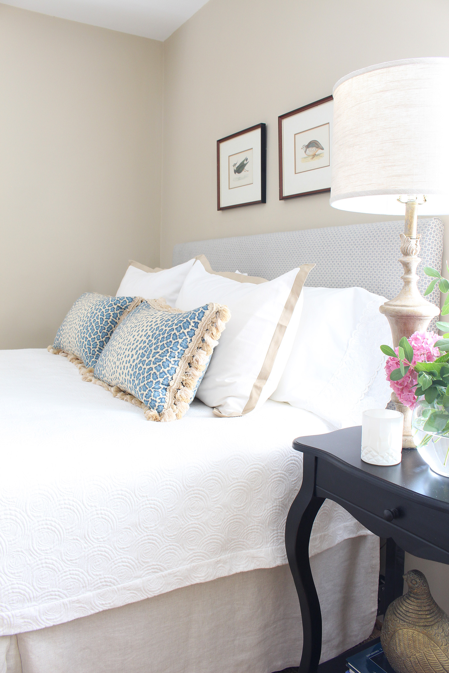 A traditional guest room gets a quick makeover with new linens, a custom headboard with fabric from Calico, and by shopping the house for the finishing touches. // DIY headboard, easy upholstered headboard