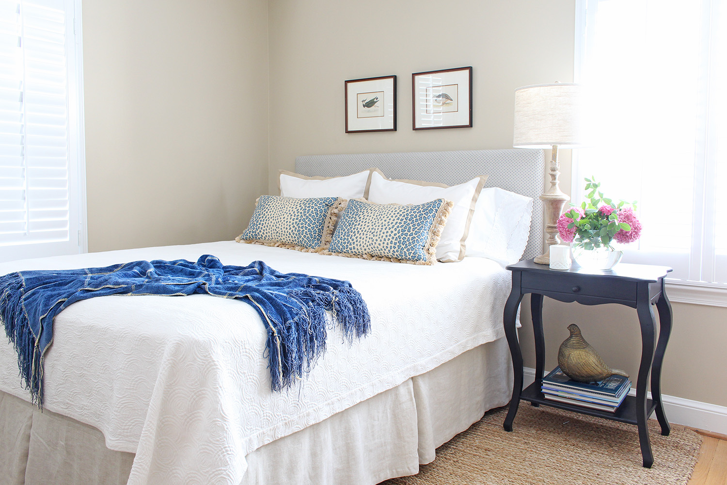 A traditional guest room gets a new look with a custom DIY upholstered headboard along with some other pieces from around the house.