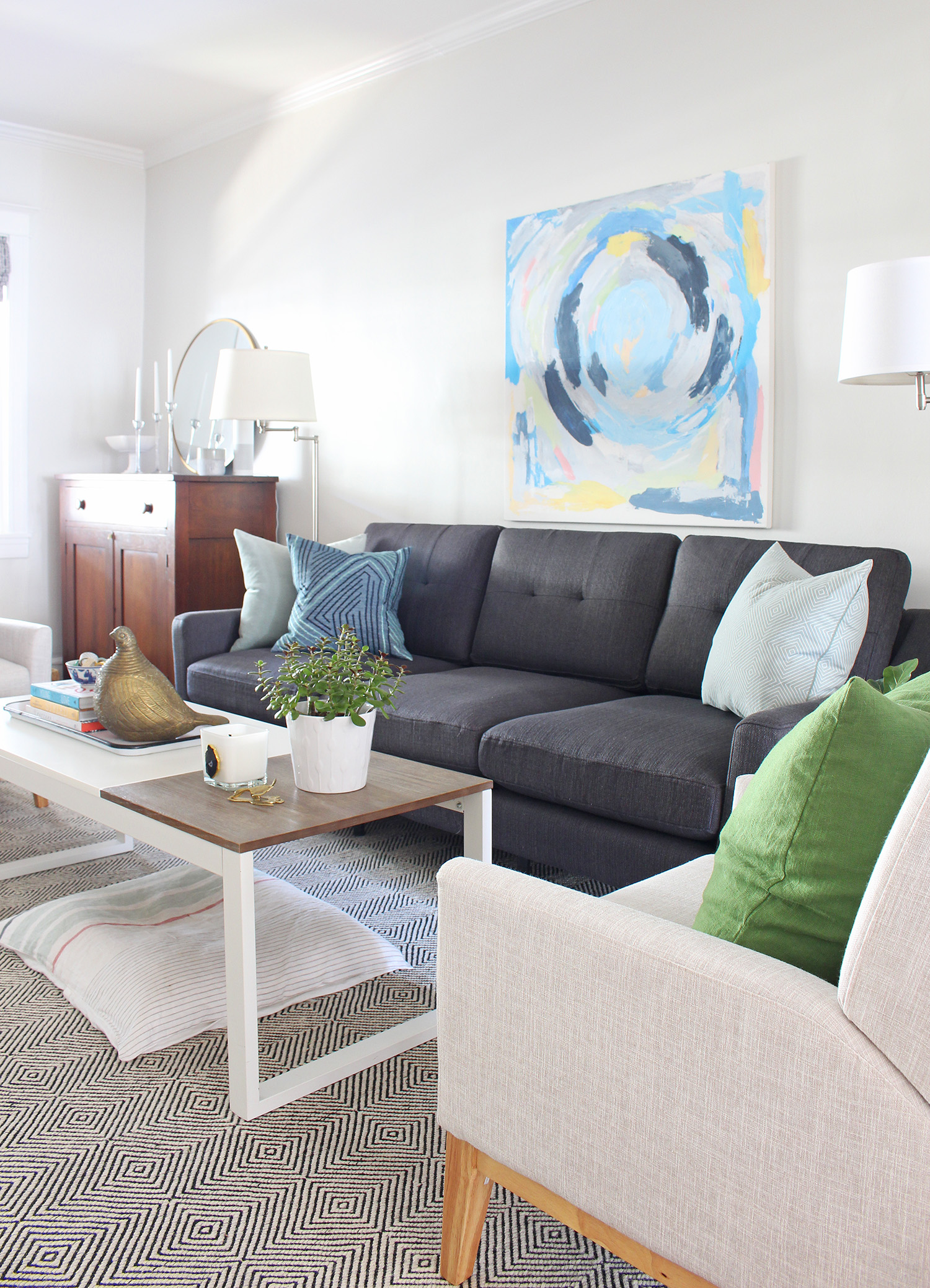 Burrow sofa in charcoal in this mid-century modern eclectic living room. Enter code MIXANDMATCH at checkout to get $50 off of your purchase!