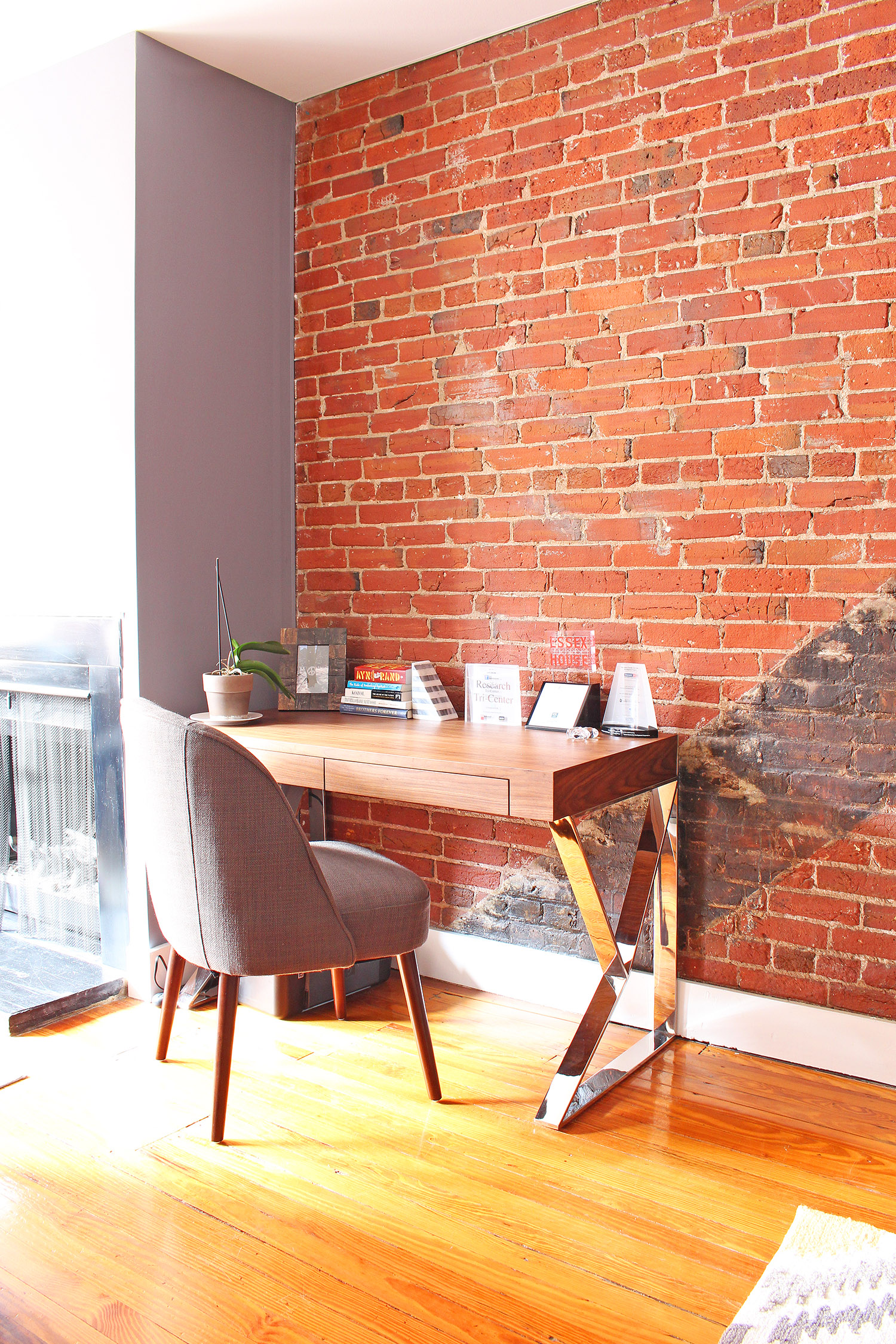 Contemporary meets classic in this converted textile factory condo's office corner in Philadelphia // contemporary dining room, transitional dining room, exposed brick