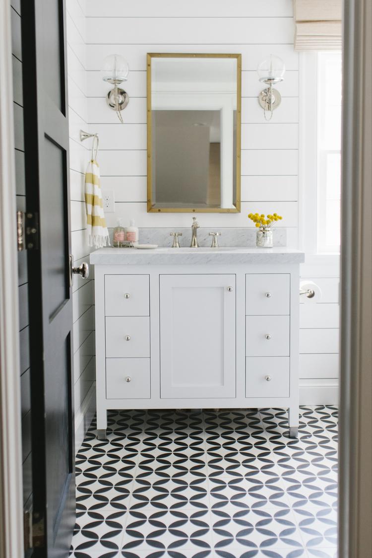 Shiplap in a powder room by Studio McGee // patterned floor tile, modern farmhouse bathroom