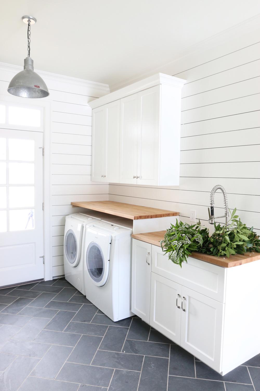 Laundry room with shiplap walls and herringbone tile floor // shiplap walls