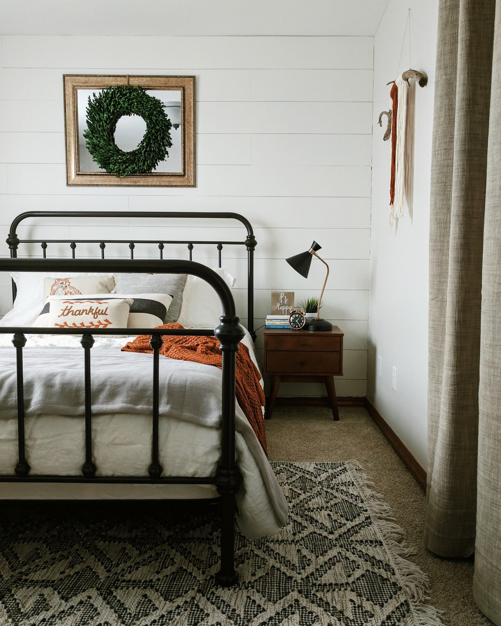 Modern farmhouse bedroom with shiplap wall // shiplap wall in bedroom