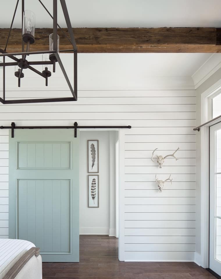 Shiplap wall in a bedroom with a barn door // aqua barn door // shiplap walls