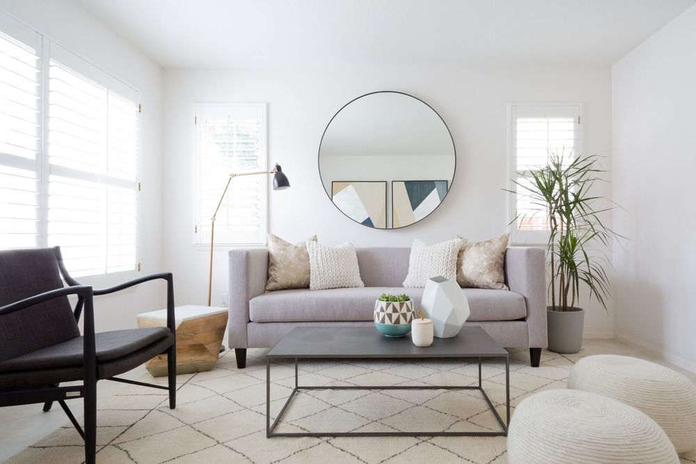 """Using """"leggy"""" furniture or pieces with glass/acrylic make a room feel more open. Get more small space decorating tricks on the Mix & Match Blog!"""