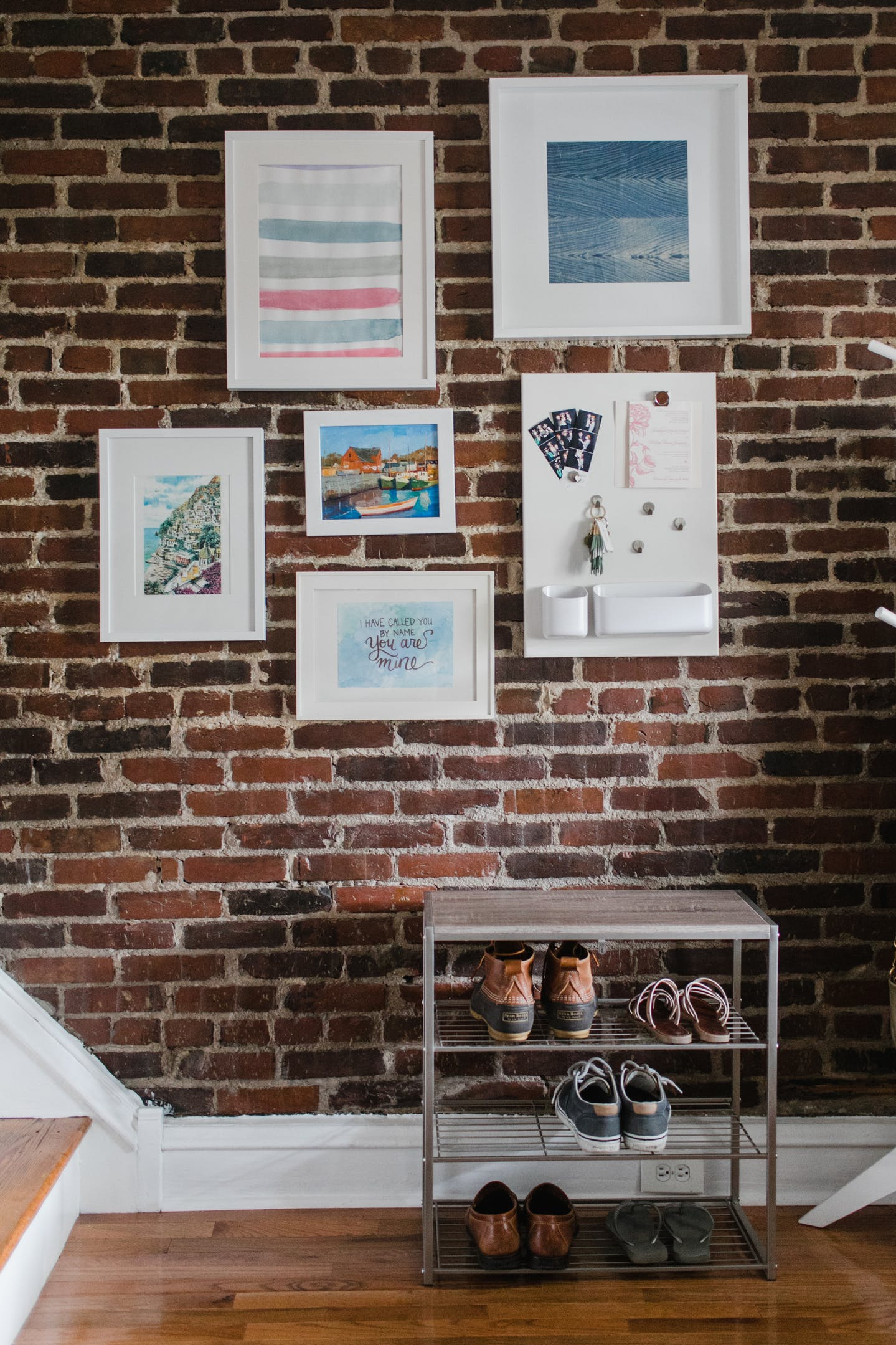 Come see Mix & Match Design Company's eclectic modern house tour on Apartment Therapy! | Exposed brick entryway.