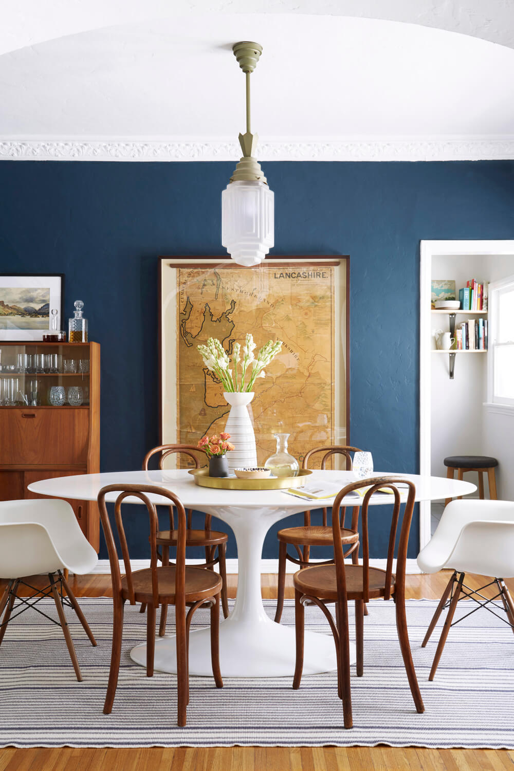 Modern Traditional dining room from Emily Henderson. Paint color: Farrow & Ball Stiffkey Blue
