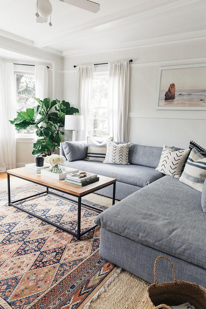 Layered-Rugs-Gray-Sofa-Modern-Eclectic-Living-Room.jpg