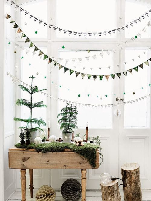 Hang a few holiday-themed buntings or garlands together for simple Christmas decor. // Scandinavian Christmas decorating, simple holiday decor, minimalist holiday decor