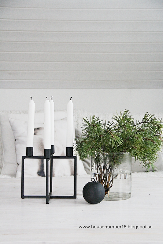 Fill vases with pine branches as simple holiday decor. // branch in vase, simple Christmas decor, minimalist holiday decor, Scandinavian Christmas decor