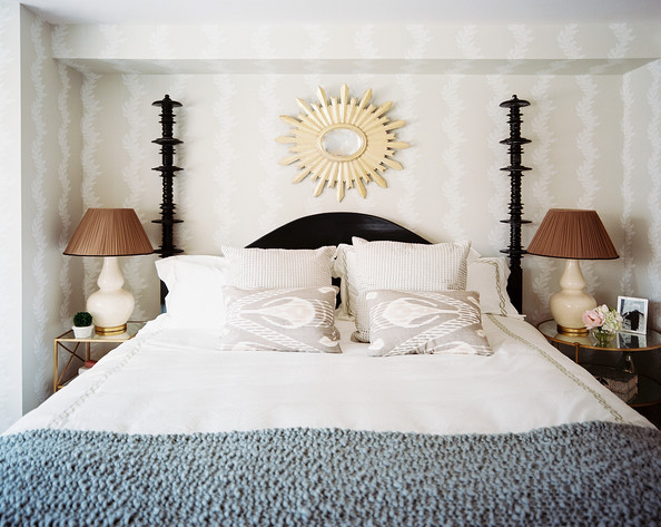 Is it possible to use mismatched nightstands in your bedroom? Absolutely! Find out how to do it well in this blog post. Here's a beautiful example in a small traditional bedroom with gold bedside tables.