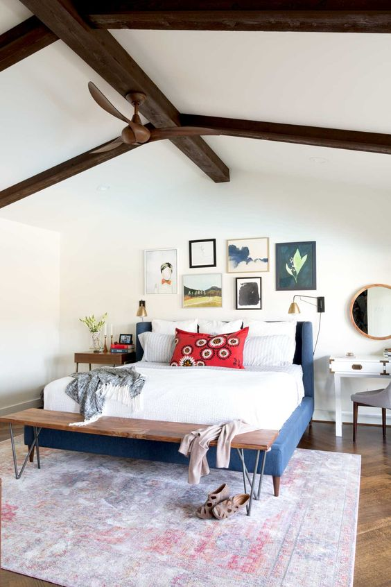 This bright and happy master bedroom shows a great example of how to mix different nightstands. Find more mismatched nightstands on the blog and how to make sure they look good together!
