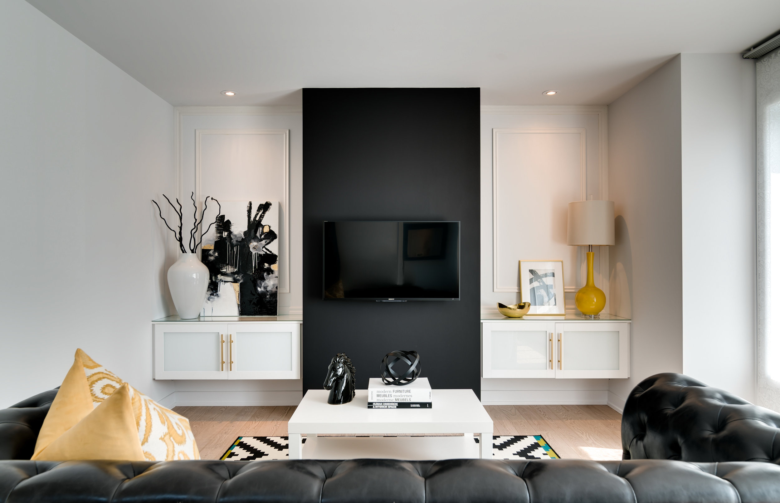 How to decorate around a TV. Hide it by painting the wall behind it a dark color.Come see other ideas and inspiration in this blog post!