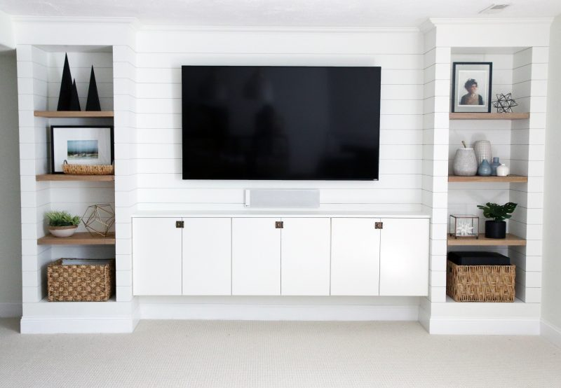 How to decorate around a TV. Distract from that big black box by adding beautifully styled bookshelves around it.Come see other ideas and inspiration in this blog post!