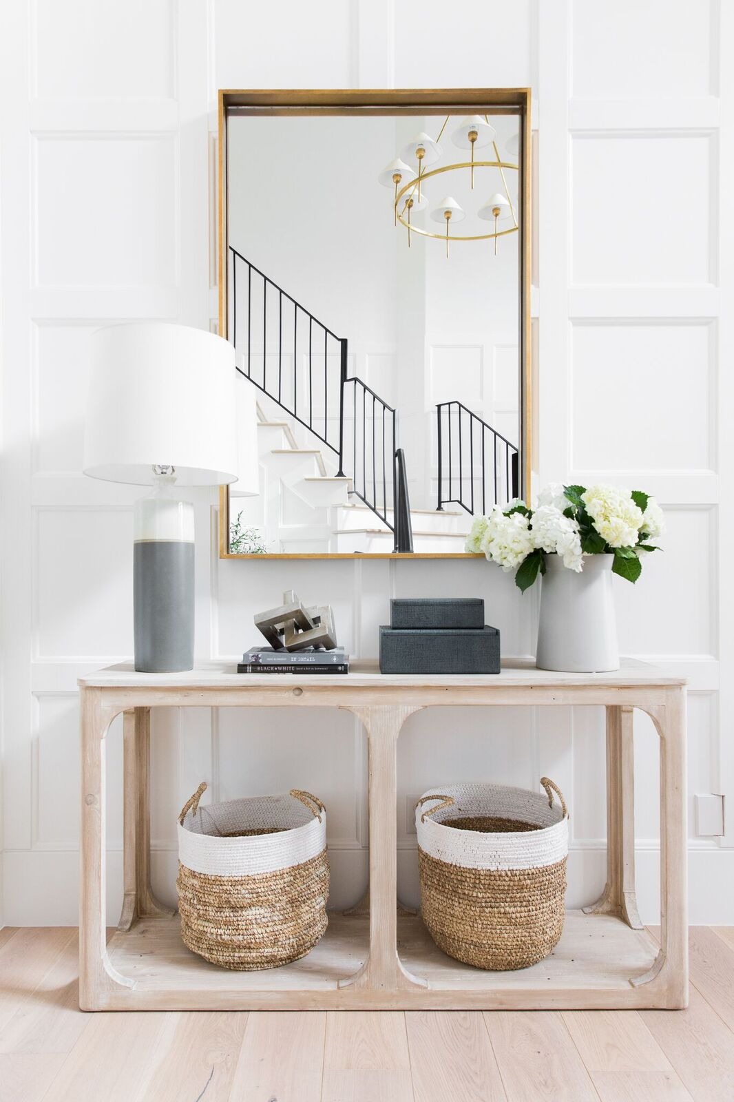 Add a console table to create an entryway and drop zone. Make an entryway even if you don't have a true foyer. See more creative entryway ideas on the Mix & Match Design Company blog!