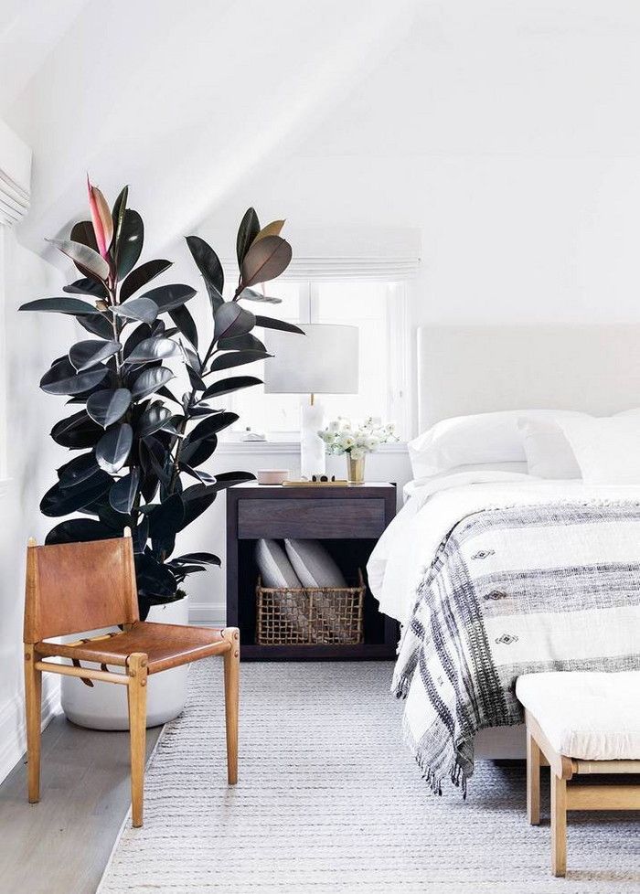 This beautiful modern meets Scandinavian bedroom is full of texture, neutral bedding and textiles, and warm woods. Plus, how amazing is that plant in the corner!?