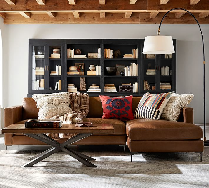Love the look of this moody, masculine living room? That leather sofa with chaise is gorgeous, and ready for your next Netflix binge. Find out how you can get the look of this room on the Mix & Match Blog.