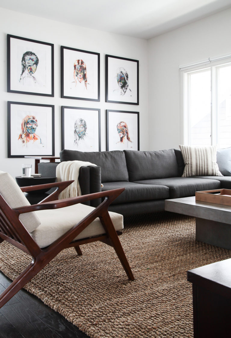 Love this moody, modern, and masculine living room? Head to the blog to find out how you can get the look inspired by this neutral living room and others!