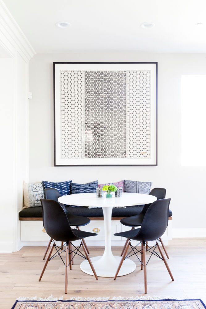 A simple, modern breakfast nook with built-in bench and a white pedestal table. Get the look of this design on the blog!