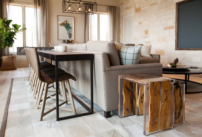 Ever wondered how you can create a dining area in a small space? Head to the blog for some creative ideas. This clever space uses a sofa table with dining chairs behind the couch!
