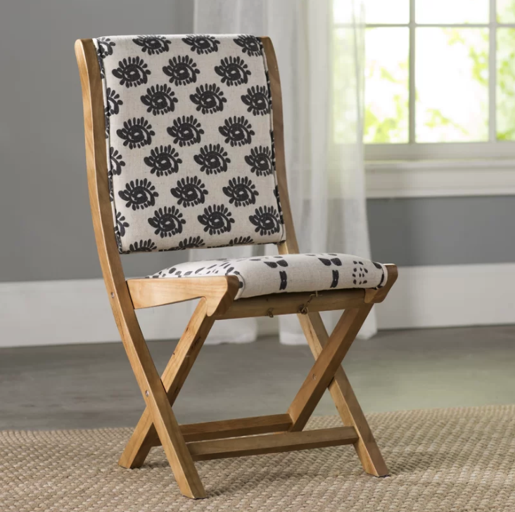 Beautiful upholstered folding dining chairs with pattern.
