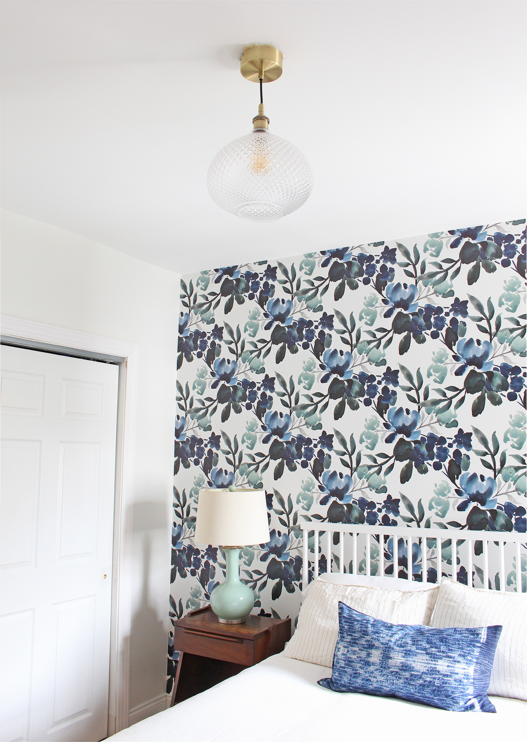 Catch a glimpse of the progress in this One Room Challenge Guest Bedroom. This week, a new cut glass pendant light from Lamps Plus went up! It's the perfect subtle, but unique touch to complement the blue and green floral wallpaper.