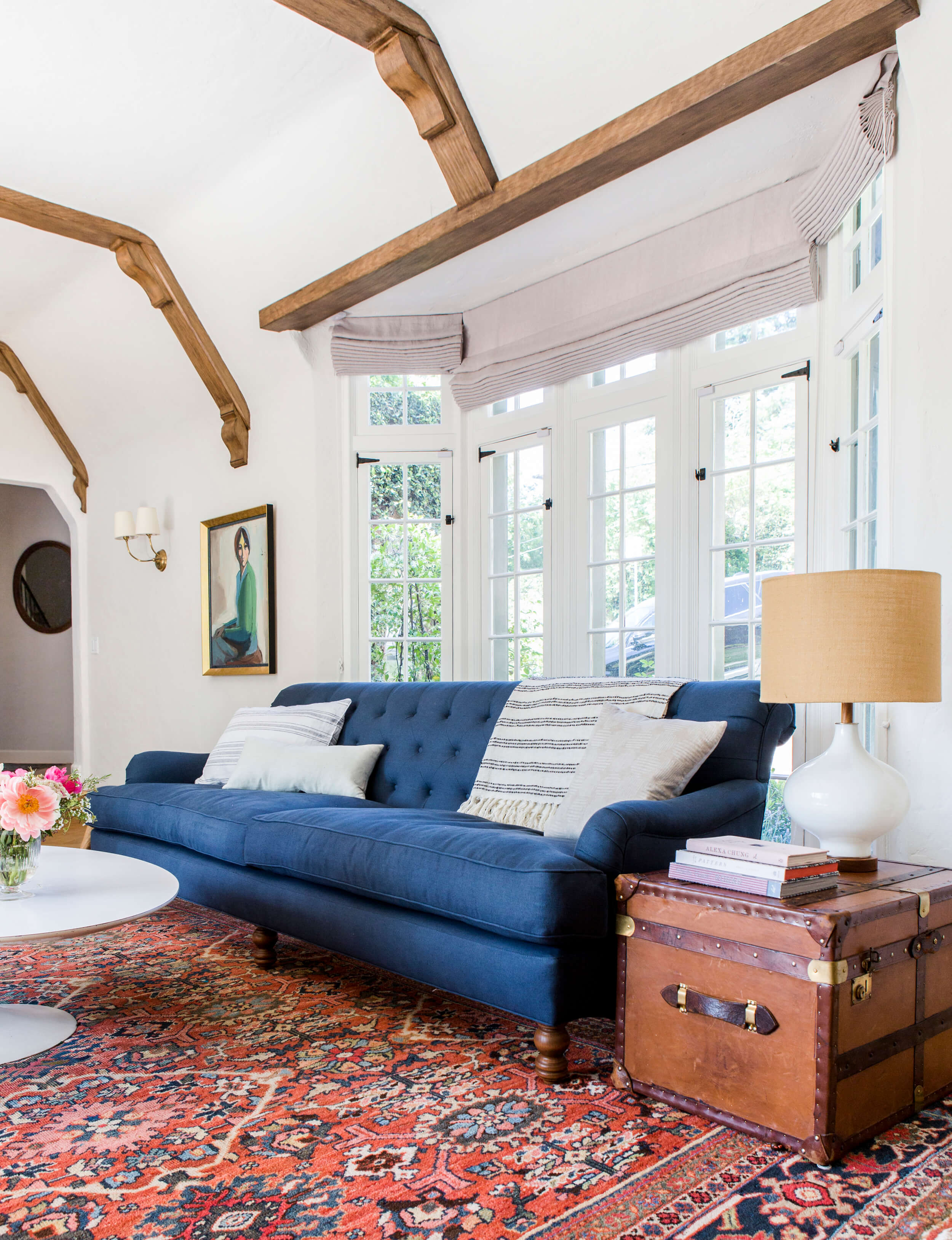 How do you choose the right side table and table lamp combination? Head to this post! I've got six no-fail combinations for you to try in your home and a lot of tips on how to choose well! // Emily Henderson's modern traditional living room with a blue sofa and a trunk as a side table.