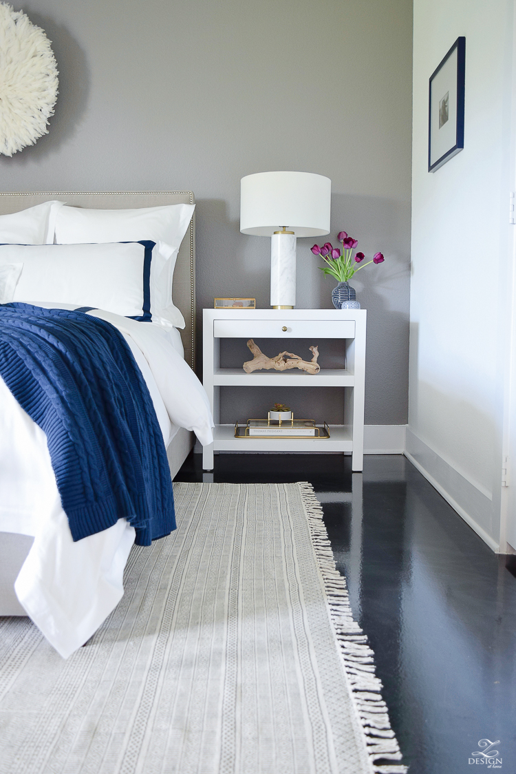 How do you choose the right side table and table lamp combination? Head to this post! I've got six no-fail combinations for you to try in your home and a lot of tips on how to choose well! // A bright and white bedroom with modern nightstands and a faux marble table lamp