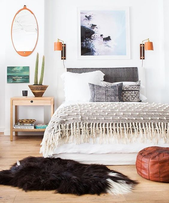 Get that casual, laid back boho coastal look in your bedroom in this post. // bright and airy bedroom, bohemian bedroom, blue, gray, white, wood bedroom.