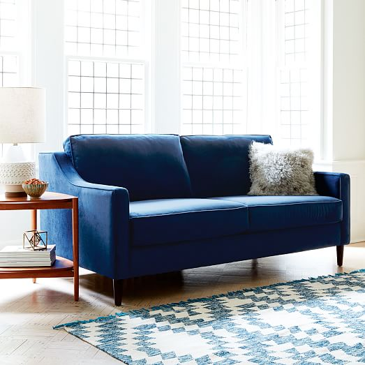 Buying a sofa soon? There's a lot to think about! Here's a guide to helping you think through how to find the perfect couch for your home. // Navy velvet sofa, how to pick a sofa, shopping for a sofa, sofa buying tips.