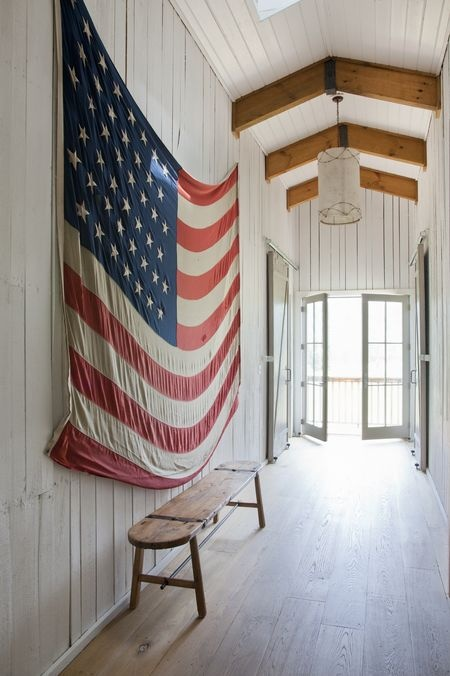 How to use American flags as decor. Hang a vintage American flag on the wall.