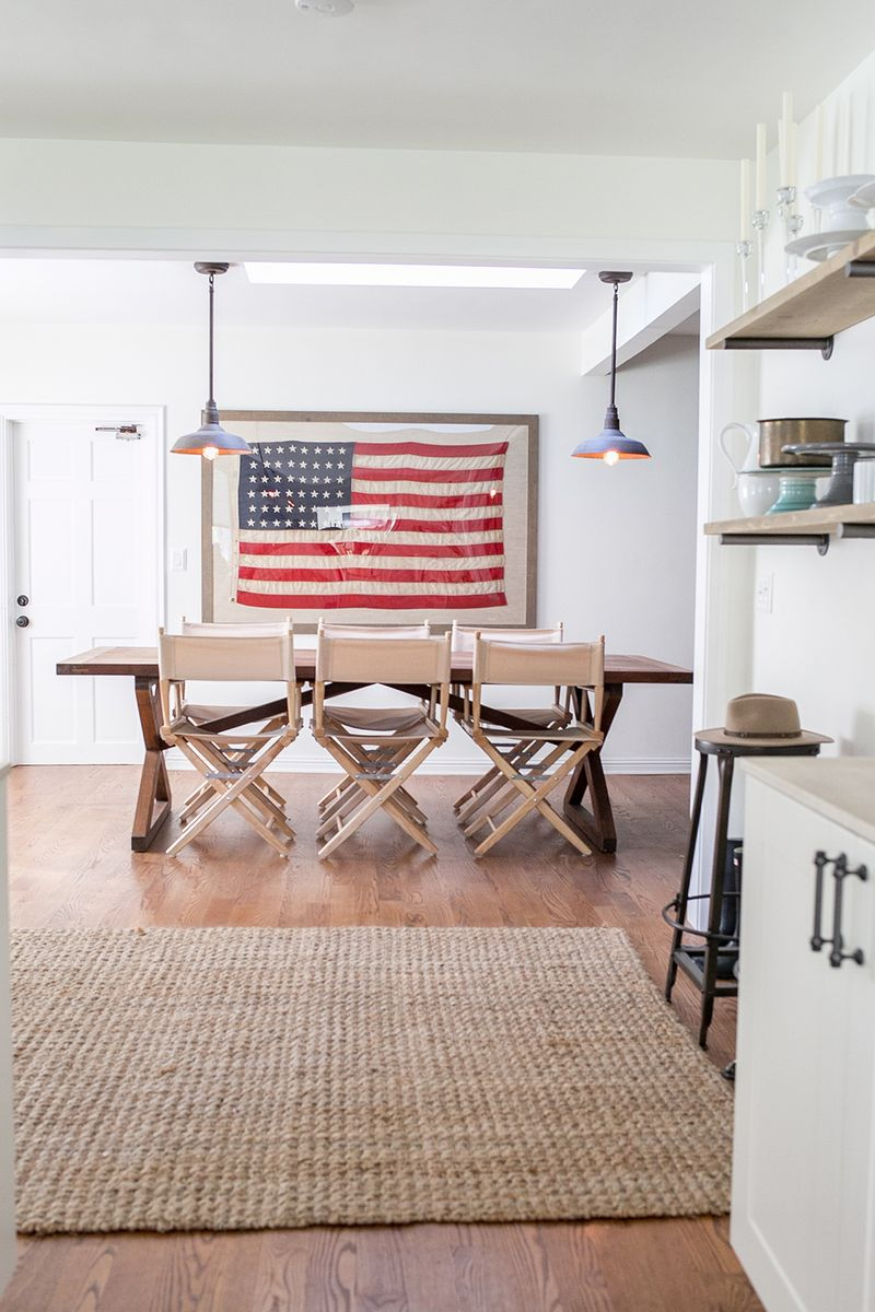 How to use American flags as decor. I love how this framed American flag looks in this simple dining room.