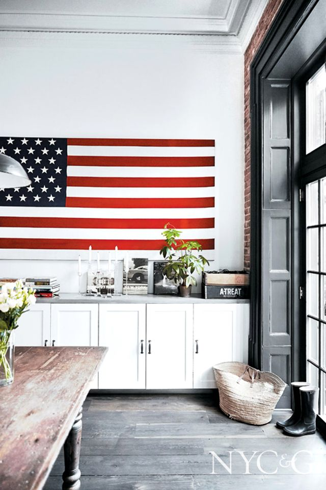 American flags as wall decor. Hang an American flag over a row of cabinetry like this family did in their Brooklyn, NY home.